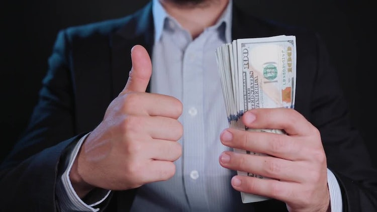 Thumb Up For US Dollars: Stock Video