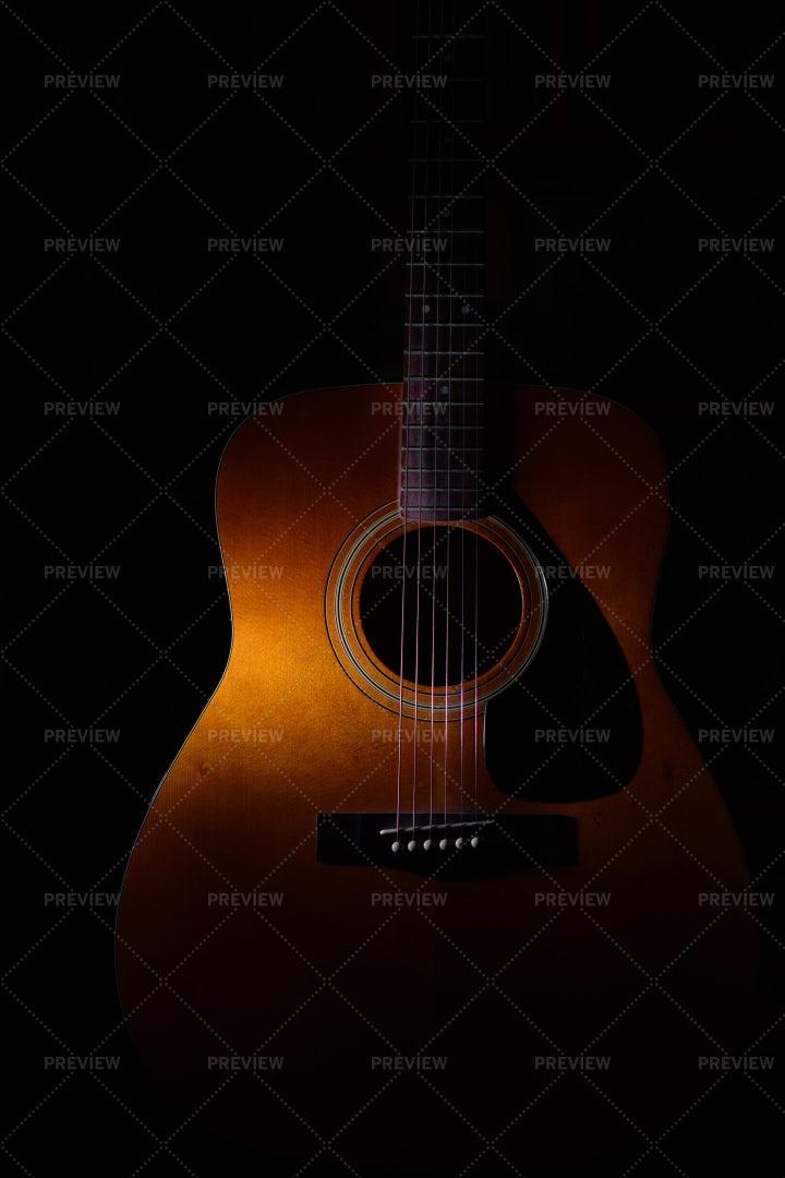 Shadow Over An Acoustic Guitar: Stock Photos
