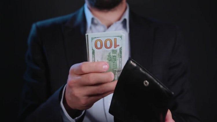 Man Puts Cash In Wallet : Stock Video