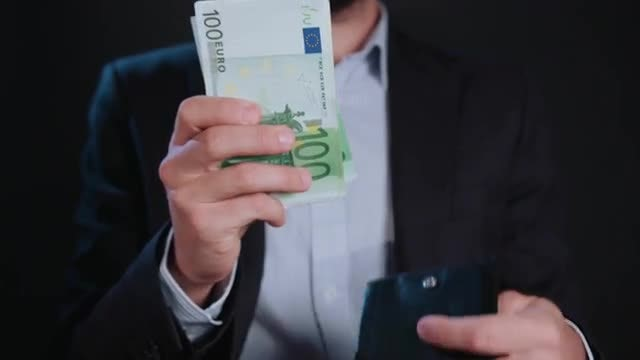 Man's Cash Out Of Wallet  : Stock Video