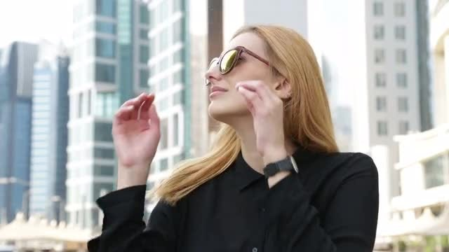 Woman and Cityscape: Stock Video