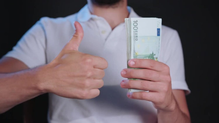 A Man In White Shirt Holding Cash: Stock Video