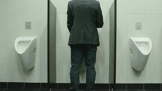 Man Peeing In Urinal In Restroom: Stock Video