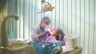 Dentist Cleans Patient's Teeth: Stock Video