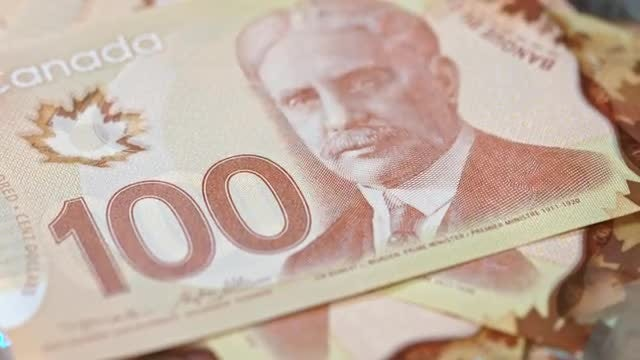 Pile Of 100 Canadian Dollars: Stock Video
