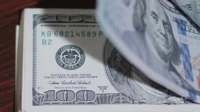 Flipping 100 US Dollar Banknotes: Stock Video