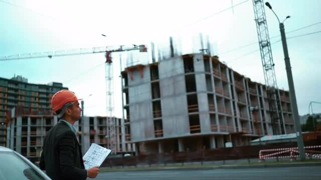 Architect Arrives At Construction Site: Stock Video