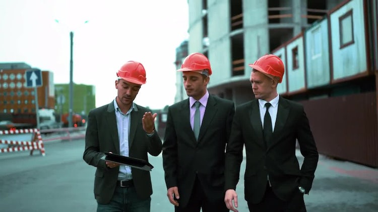 Three Architects Discuss Building: Stock Video