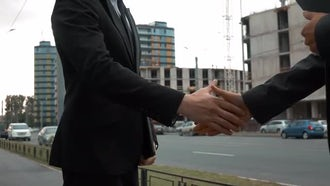 Shaking Hands By Construction Site: Stock Video