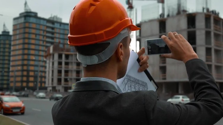 Engineer Taking Pictures of Building : Stock Video