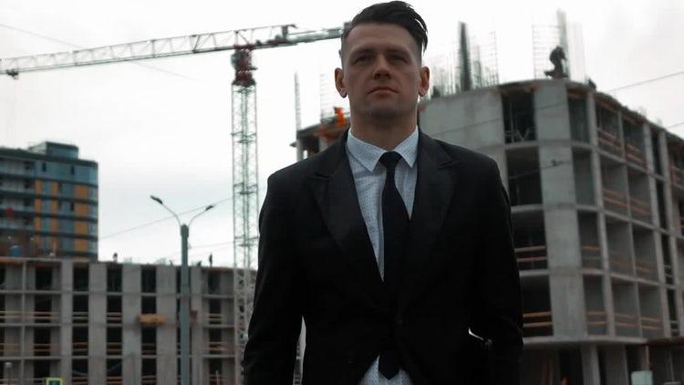 Businessman Profile In Construction Site: Stock Video