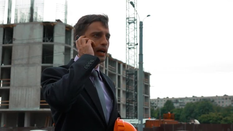 Construction Engineer Answers Phone: Stock Video