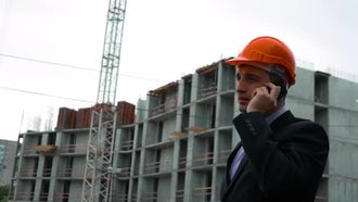 Builder Talking On Phone: Stock Video