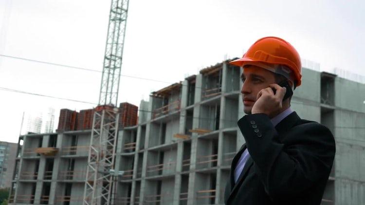 Builder Talking On Phone: Stock Video