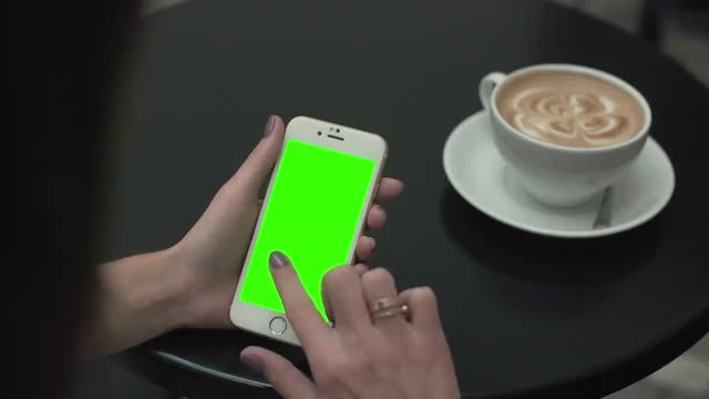 Woman Using A Cellphone with Green Screen: Stock Video