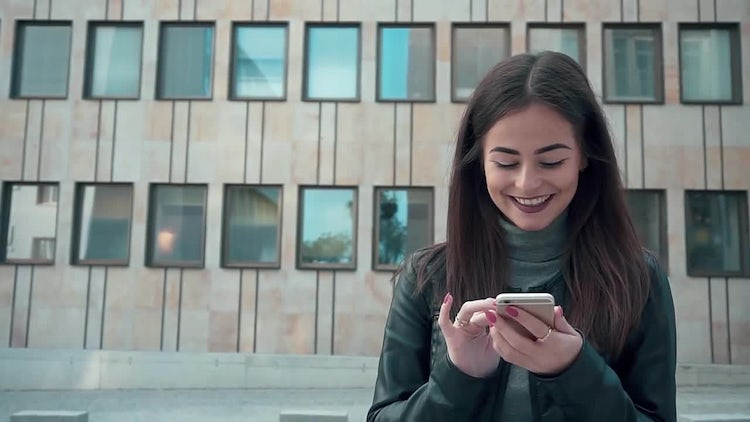 Happy Woman On Smartphone: Stock Video