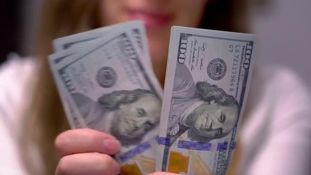Woman Counting Many American 100 Bills: Stock Video