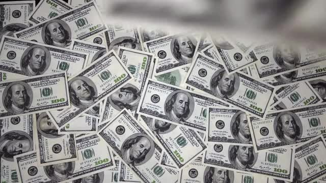 One Hundred Dollar Bills Falling Through Air: Stock Video