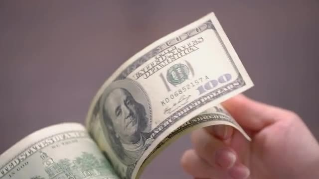 Flipping Through US Dollars : Stock Video