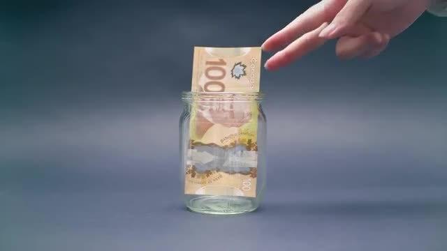 Saving Canadian Dollars In Jar: Stock Video
