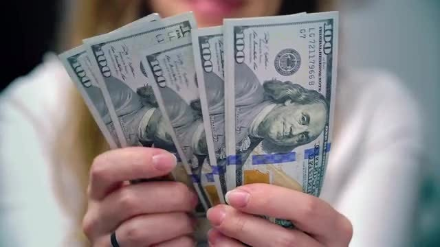 Unsatisfied Woman Counting US Dollars: Stock Video