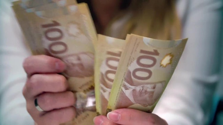 Dissatisfied Woman Counting Canadian Money : Stock Video