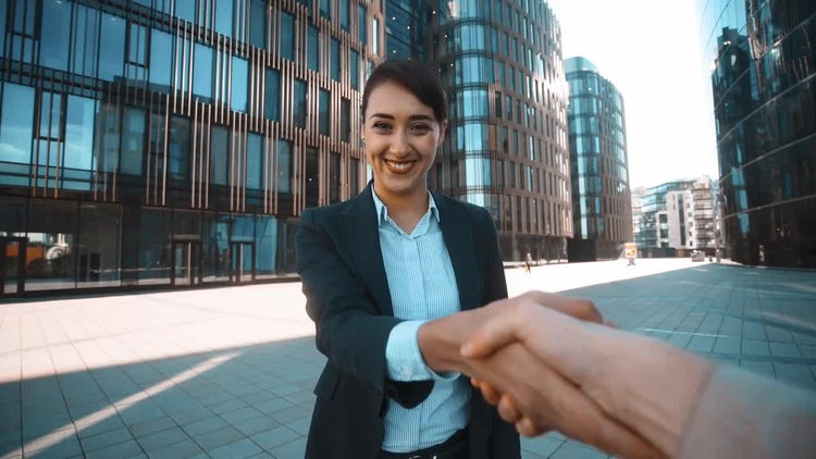 Pretty Businesswoman Handshakes With You: Stock Video