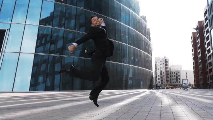 Businessman Jumping For Joy: Stock Video