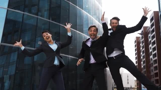 Work Team Jumps For Joy : Stock Video