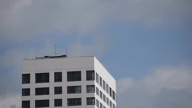 Clouds Flying Around Building: Stock Video