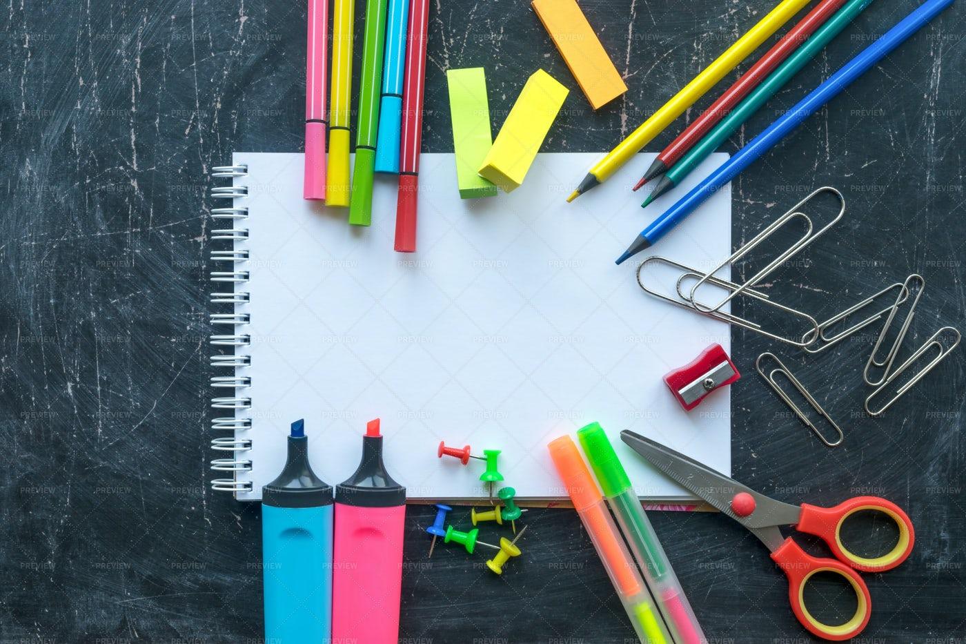School Supplies On A Chalkboard: Stock Photos