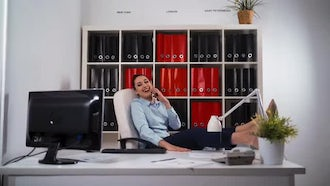 Businesswoman Relaxed In Office: Stock Video