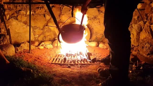 Cooking Food Over A Campfire: Stock Video