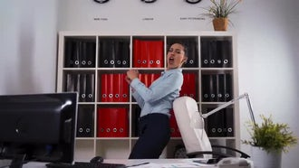 Businesswoman Dancing Singing In Office: Stock Video