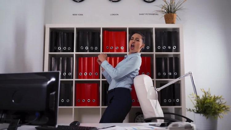 Businesswoman Dancing Singing In Office: Stock Video