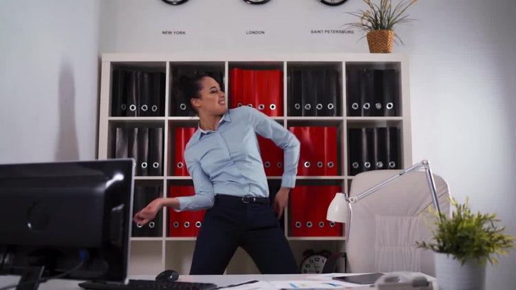 Happy Businesswoman Dances In Office: Stock Video