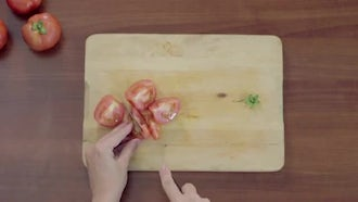 Top View Of Slicing Tomatoes: Stock Video