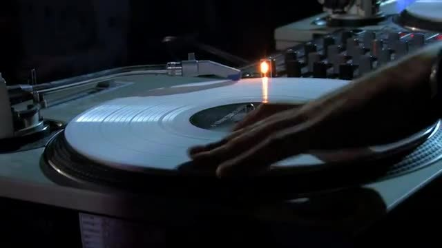 DJ Spinning Vinyl In The Club: Stock Video