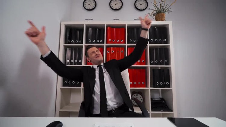 Businessman Happy And Rocking : Stock Video