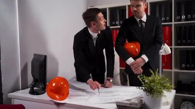 Engineer Architect Discuss Plan: Stock Video