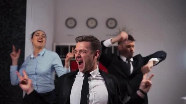 Happy Dancing Employees: Stock Video