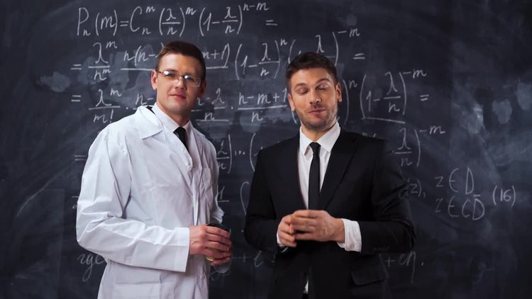 Two scientists analyzing math : Stock Video