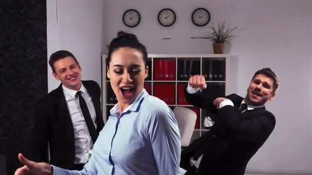 Happy Colleagues Dancing In The Office: Stock Video