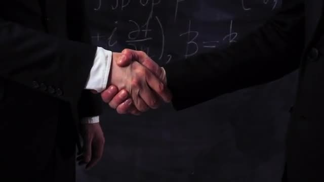 Two Scientists Shake Hands: Stock Video