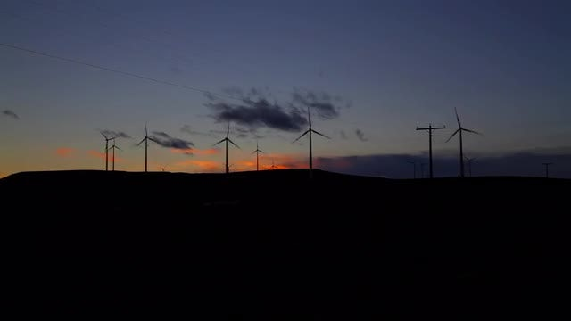Wind Farm Silhouette Wide At sunset: Stock Video