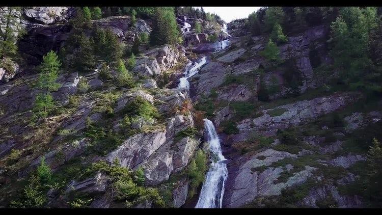 Alpine Waterfall Aerial View: Stock Video