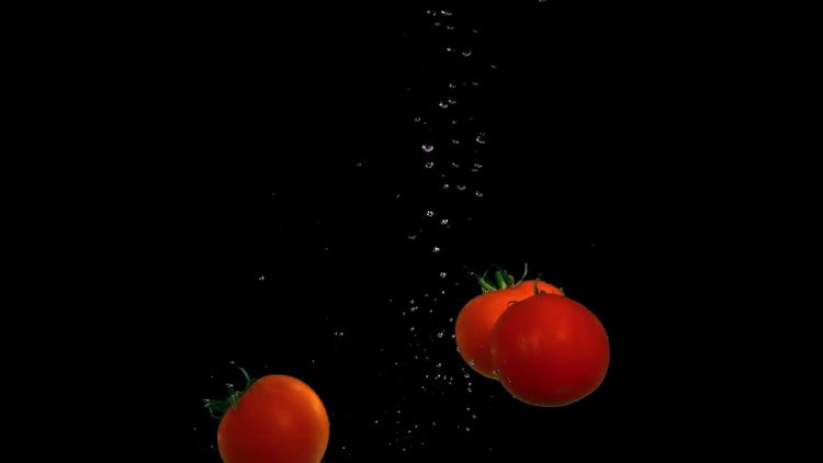 Tomatoes Dropped In Water : Stock Video