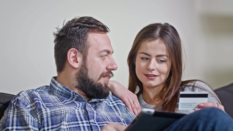 Couple Pays Online Using Tablet: Stock Video