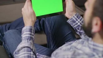 Man Sitting With A Digital Tablet: Stock Video