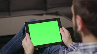 Man Surfs Net On Tablet: Stock Video